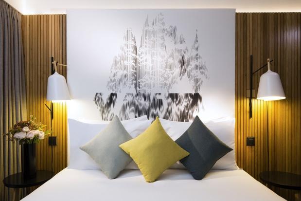 Les chambres du Drawing Hotel sont décorées dans un style contemporain avec des matières nobles associées à des pièces de designer ou d'éditeurs français - Photo : Drawing Hotel