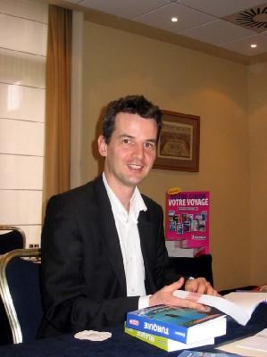 David Brabis, directeur des guides touristiques, venu à Bruxelles à l'occasion de la Foire du Livre