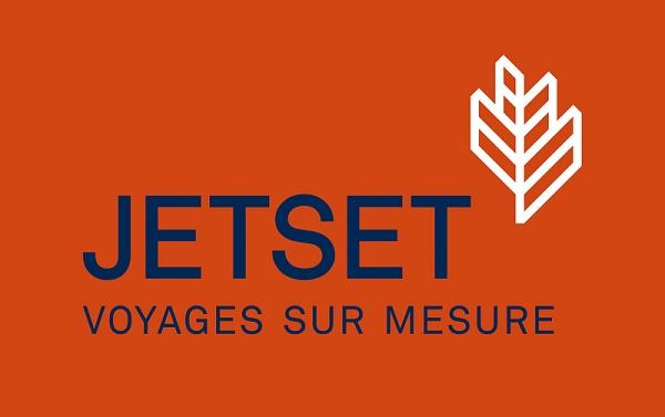 Le nouveau logo de Jetset Voyages décliné ici avec un fond orangé rouge et une police bleu marine - DR