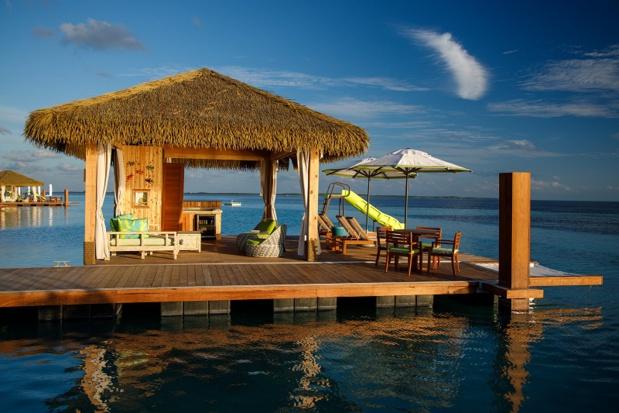 Chaque cabane dispose d'un toboggan privé se jetant directement dans l'océan - DR Royal Carribean
