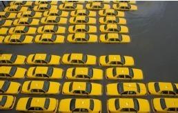 A la suite du passage de l'ouragan Sandy, les taxis new yorkais encore en service sont exceptionnellement autorisés à prendre plusieurs clients en même temps - Photo Get Americas