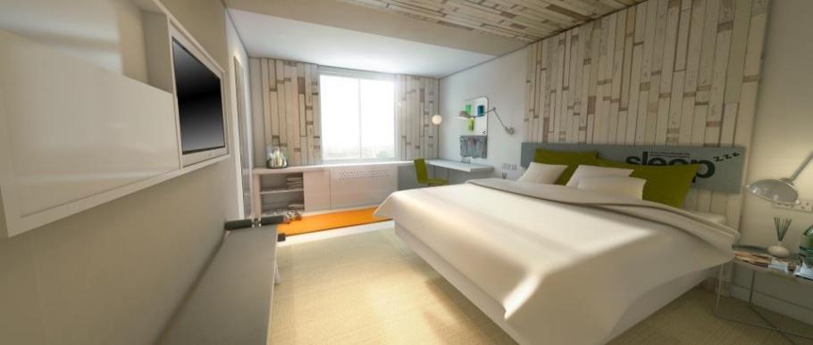 Les chambres d'Even Hotels sont conçues comme autant de salles de salles de gym avec un équipement multifonctionnel : pause bagages qui se transforme en banc d'entraînement, tapis de yoga, etc. © DR