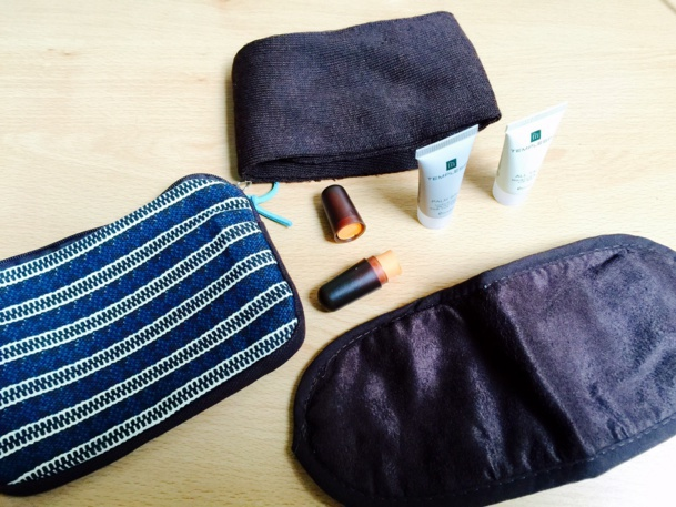 A toiletry case with the essentials: eye mask, socks, toothbrush and various lotions…/photo Jdl