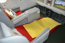 The seat is large, comfortable, made of leather, fully electric, and the space between the rows is of 1.65m - DR: Ethiopian Airlines.