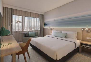 Les 306 chambres et suites de l'hôtel affichent une décoration inspirée du littoral urbain - Photo : Marriott Hotels