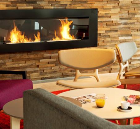 Les clients des hôtels de Nomad Hotels peuvent profiter d'un espace de vie pour se détendre et se rencontrer - Photo : Nomad Hotels