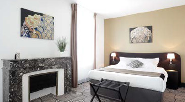 The historical elements were preserved in the suites of the Appart'City Nîmes Arènes - Photo : Appart'City