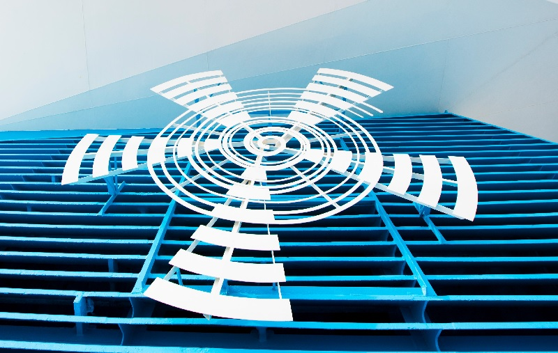 L'emblème de la compagnie, La spirale d'une coquille inspirée d'un chapiteau  antique se dessine sur  les ailes d'un moulin à vent.