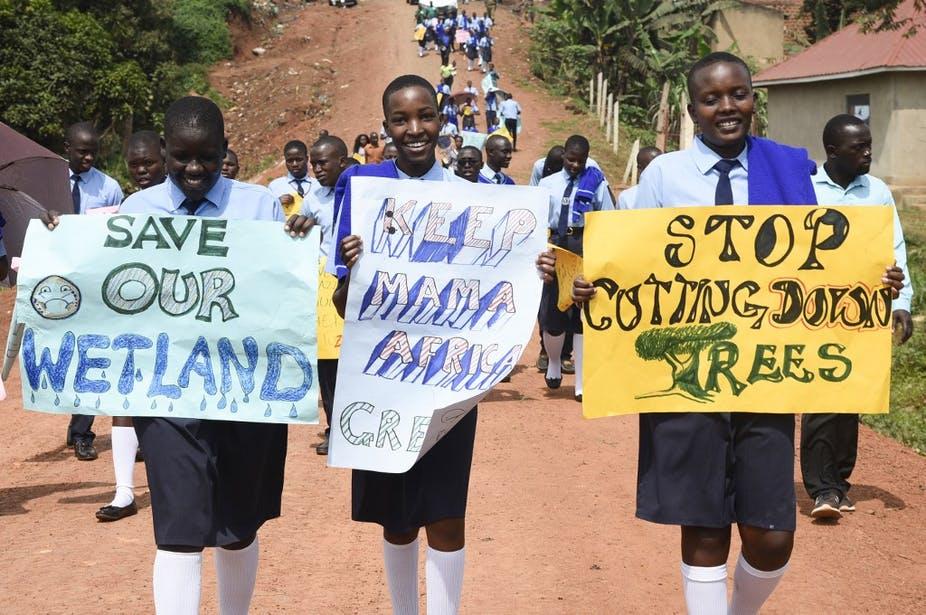 De jeunes Ougandais prennent part à une marche pour le climat, le 20 septembre 2019 à Wakiso. Isaac Kasamani/AFP