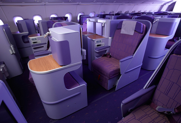The 60 business units are cocoons in purple leather, arranged 1-2-1 width, offset and sufficiently staggered to be protected from other's view - DR: Thai Airways