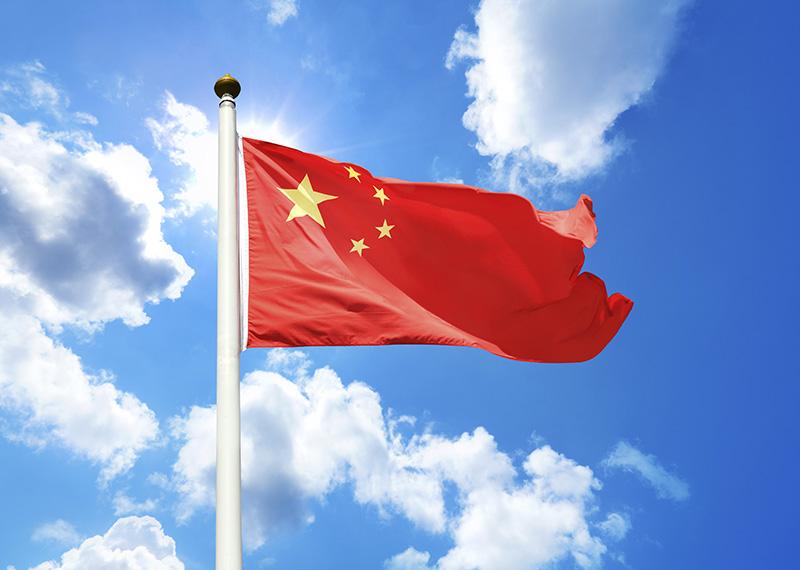 Les groupes chinois tels que Fosun ou HNA s'intéressent de près au secteur du tourisme en Europe, et notamment en France - China Flag © estherpoon
